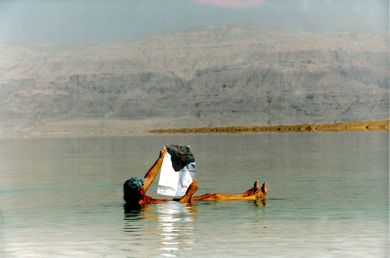 Israel: Leisurely reading in the highly buoyant Dead Sea <br /> (try doing that in your swimming pool).