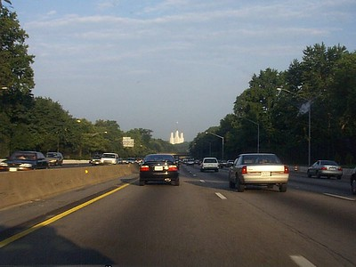 This is a shot of the Mormon Temple as John and myself cruise down the outer loop of the Gauntlet, aka the Capital Beltway, that snakes its way around Washington DC. I looks a lot prettier than you can see here but I couldn't get a decent shot of it up close when we passed by it that day, so this is it. They did a great job spending that 10% of their followers incomes, I must say. Its real pretty, but we see it eeevery day.