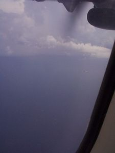 The light-to dark pattern in the middle of the picture is  the rain from the thunderstorm hitting the water while another  plane passed in the distance. Didn't come out too good,  unfortunatly.