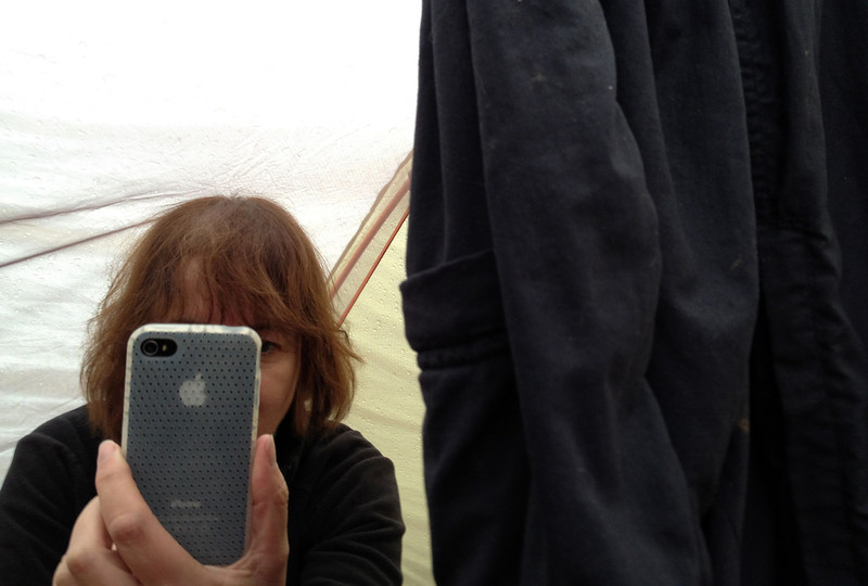 iPhones provide amusement while stuck in tent