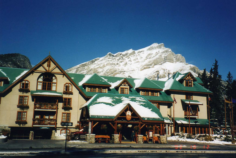 Caribou Lodge, our hotel in Banff, with Mt. Cascade in Background (sun has melted some of the snow on the roofs)
