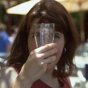 Patty drinking her first Australian Beer Steve's tavern Perth, Australia
