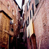 tiny, ancient streets within walled city of Siena.