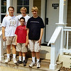 Brad & Tracey, Kevin & John at the entrance to our resort