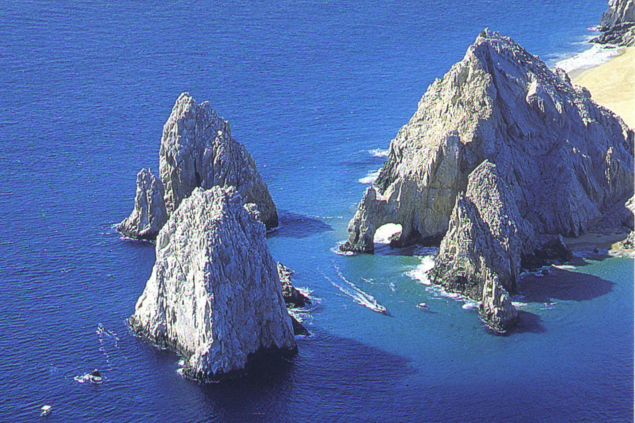 Rocks just outside Cabo San Lucas (from post card). Notice the arch.