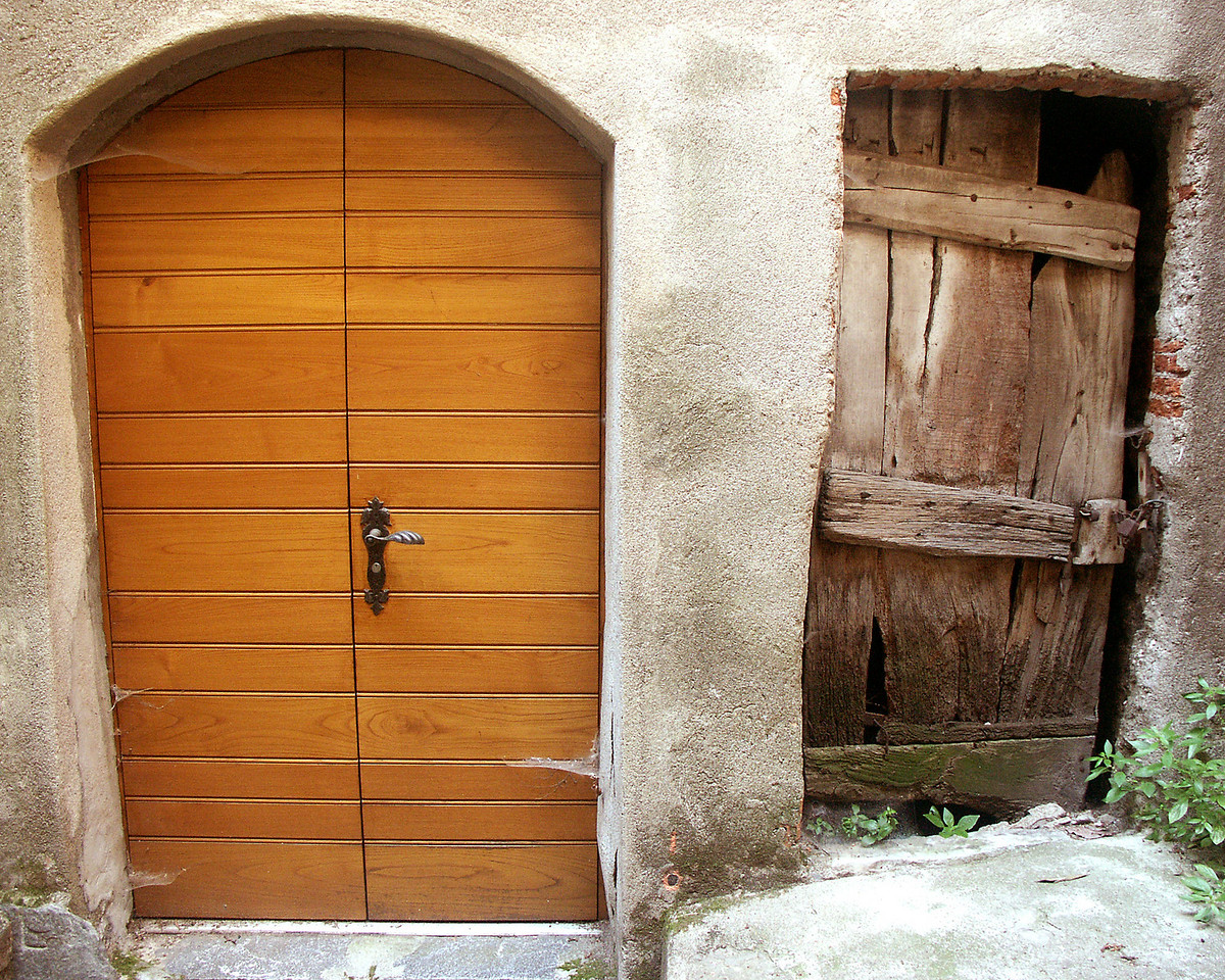 Side-by-side doorways - one modern and the other ancient - in the town of Gandria on Lake Lugano.