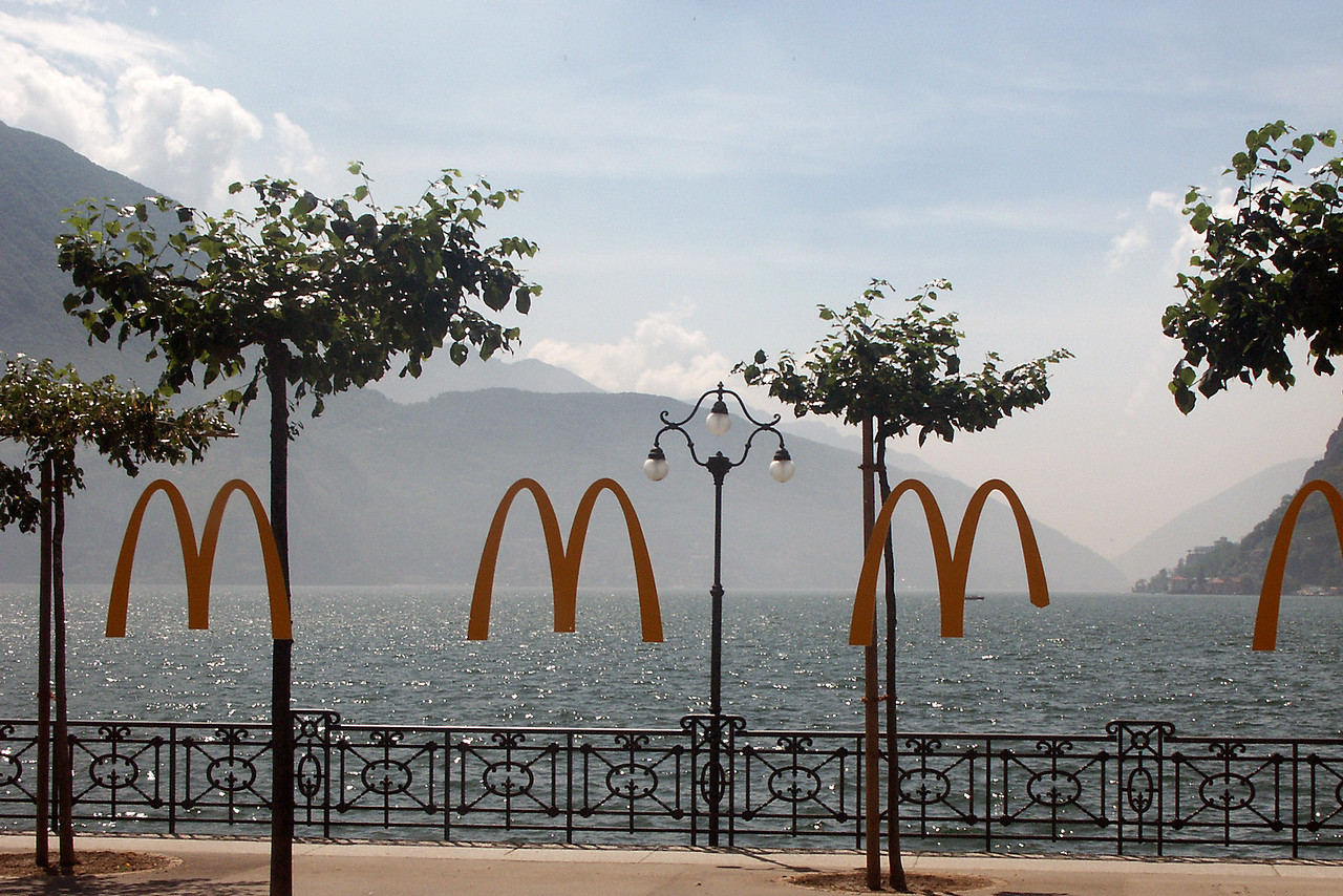 Another view of Lake Lugano through the window of a MacDonalds.