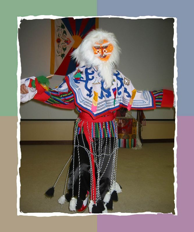 A masked colorful Tibetan dancer [color block 01 frame]