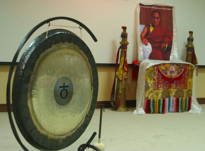 Metal gong with His Holiness the Dalai Lama in bg