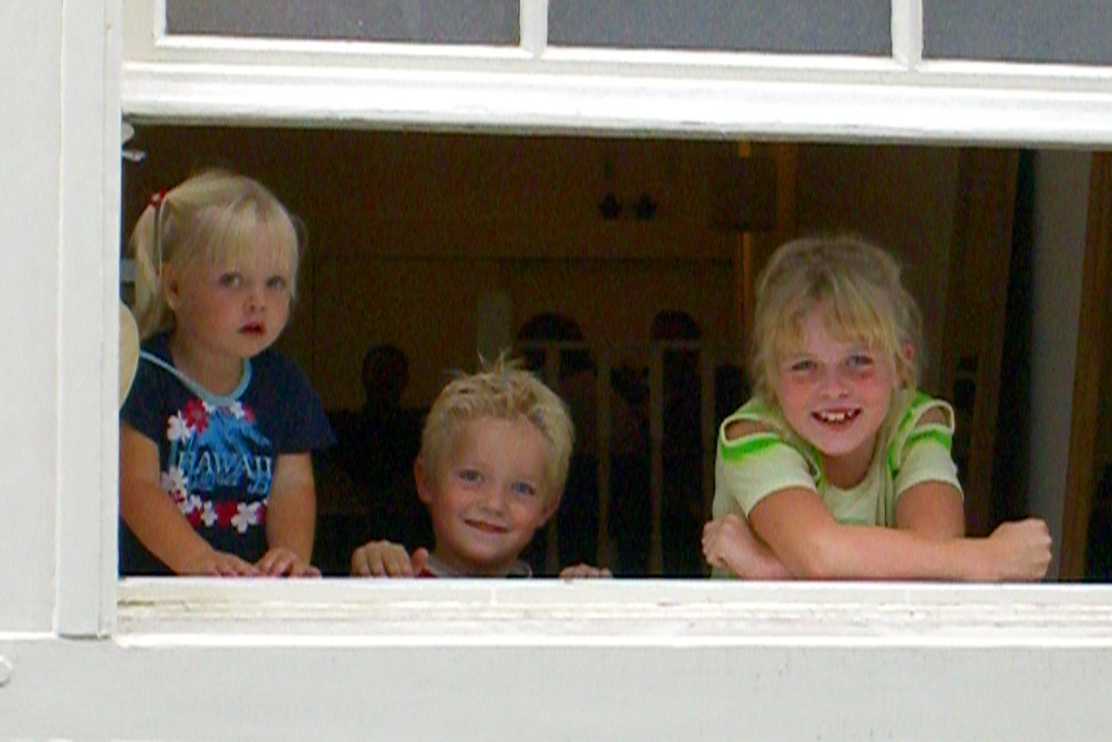 Just a group of kids looking out their window. If Amstedam isn't famous for its kids, I think it ought to be.