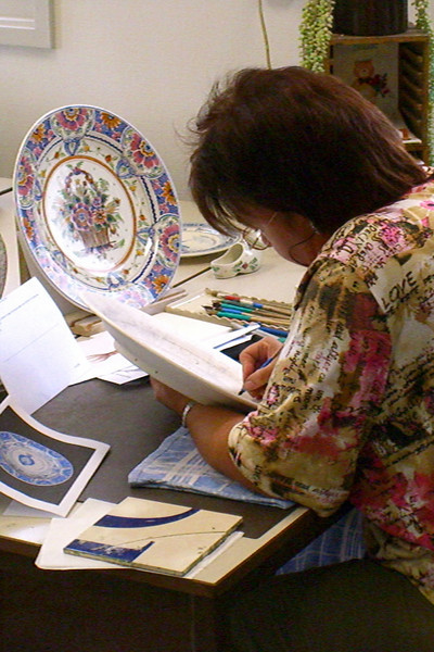 Here's a shot of one of the artists painting a piece of pottery in the Delft factory.