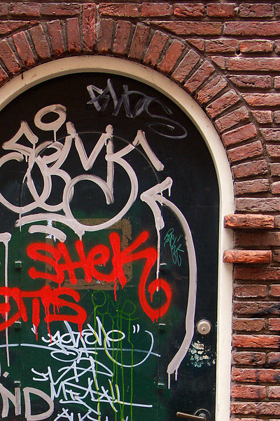 "There is an awful lot of graffitti in Amsterdam. Of course I could use this photo for my club's ""doorway"" challenge."