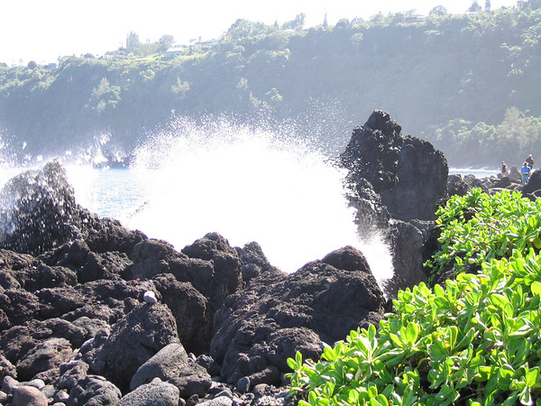 The town of Laupahoehoe sits atop the cliffs above a small harbor. Laupahoehoe Point juts out into the ocean just above sea level.