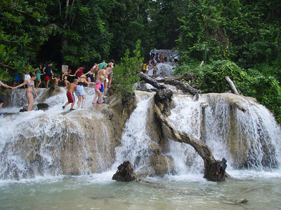 Climbing Dunn's River Falls In Ocho Rios, a Jamaican tradition.  It is exciting to climb and not very dangerous.   No way would the American government allow this.  Lawsuits would abound.