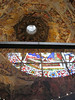Inside Brunelleschi's Dome with stain glass reflection.