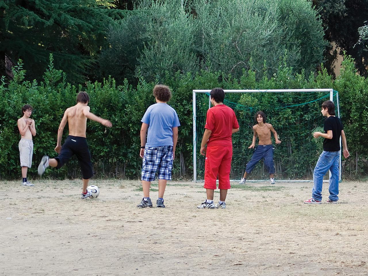 Boys playing futbol in Chiusi park