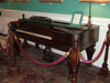 Old piano in the Menger Hotel, once used by Theodore Roosevelt to recruit his Rough Riders