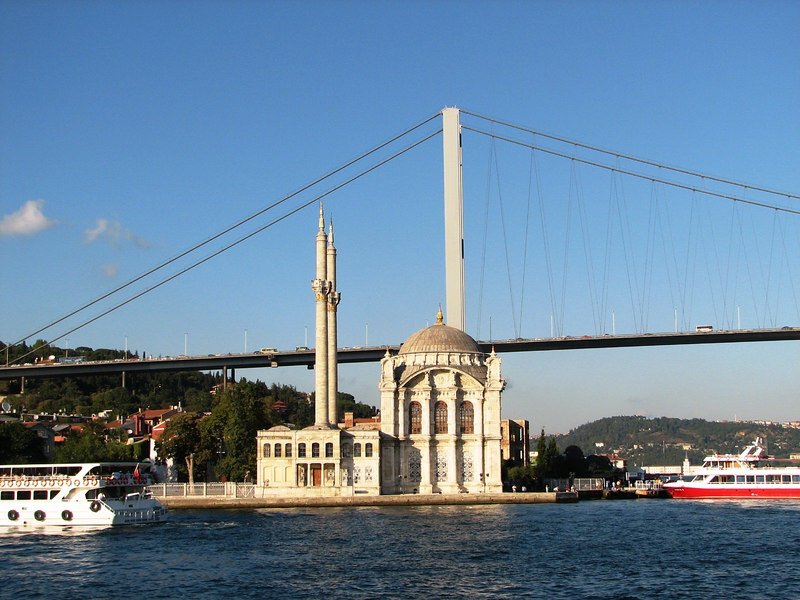 This bridge spans the Bosphores connecting Europe and Asia. There is a small distinctive mosque sitting on some land reclaimed from the Bosphorus.