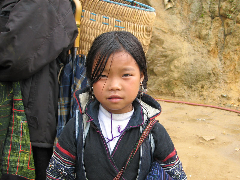 This little girl was named Ju.  She knew just enough English to be a dynamite little saleslady.  She stuck by our side for a couple of miles and eventually landed a sale for a $3 silver bracelet.