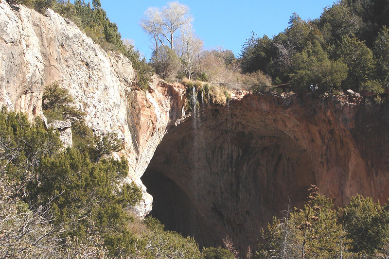 Tonto Natural Bridge. It is believed to be the largest natural travertine bridge in the world. The bridge stands 183 feet high over a 400-foot long tunnel that measures 150 feet at its widest point.