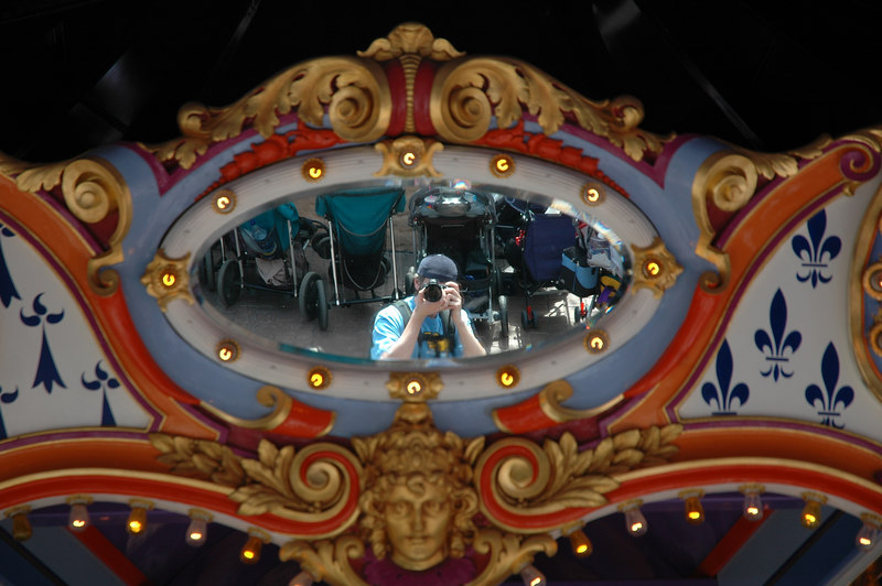 A picture of me through the merry-go-round mirrors.