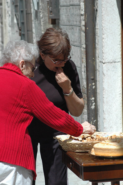 Adriene and Yolanda snack on treats.
