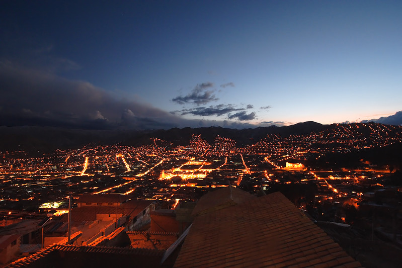 Cusco Peru just past sunset.  The Plaza de Armas and the Qoricancha are the bright objects in the center of town.