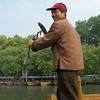 Sculling boat oars man