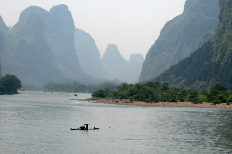 "The city of Guilin (pronounced gwee-lin) in the southwest of China. It has some of the most beautiful scenery in the country. This is a view of the Li river that runs through the city. The area is populated by numerous hump-backed limestone mountains called ""karsts."""