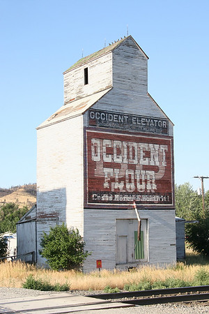 Grain elevator in Reed Point, MT. The main street looks like it is still in the 1800's.