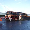073 pulls the train forward over the level crossing at Ballina. Sat 09.12.06