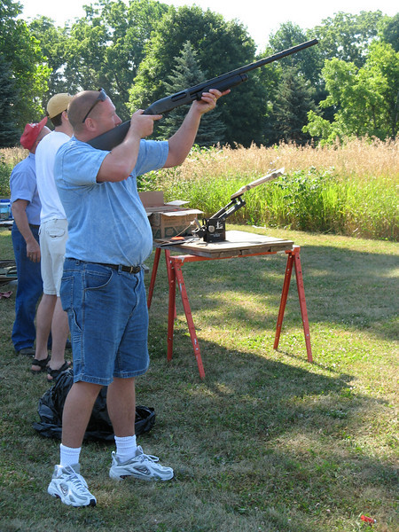 Each year over the 4th of July weekend, the Morris family holds a skeet shoot out at Cullen's grandparents house in Allegan, Michigan.  Everyone who wants to compete pays $5, and then there are 5 rounds of 5 shots each.  Here's Matt taking his turn.
