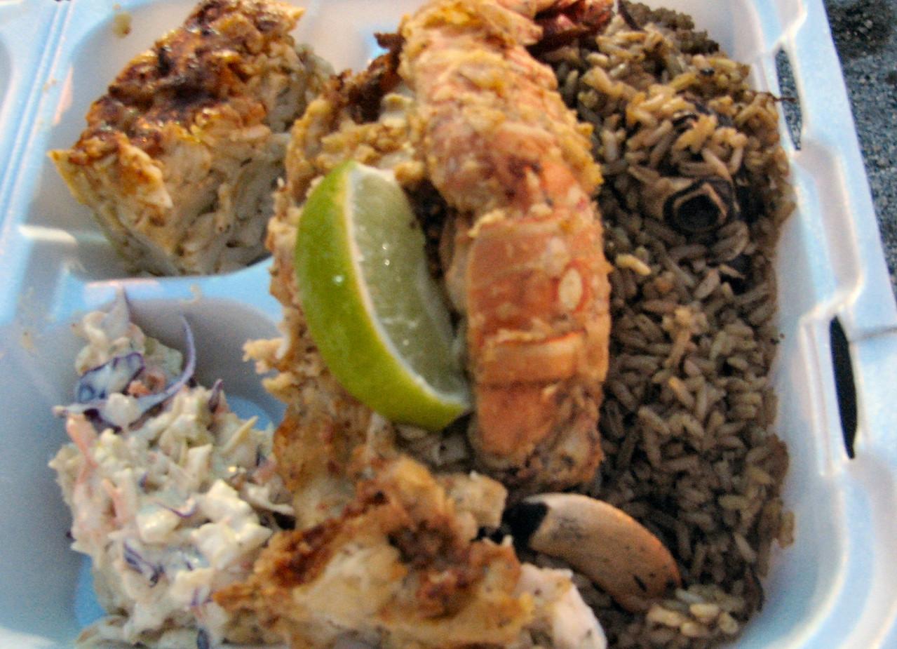 Dining at the festival.  Lobster, cole slaw and crab rice.<br /> <br /> Cenando en el festival.  Langosta, ensalada de col y arroz con cangrejos.