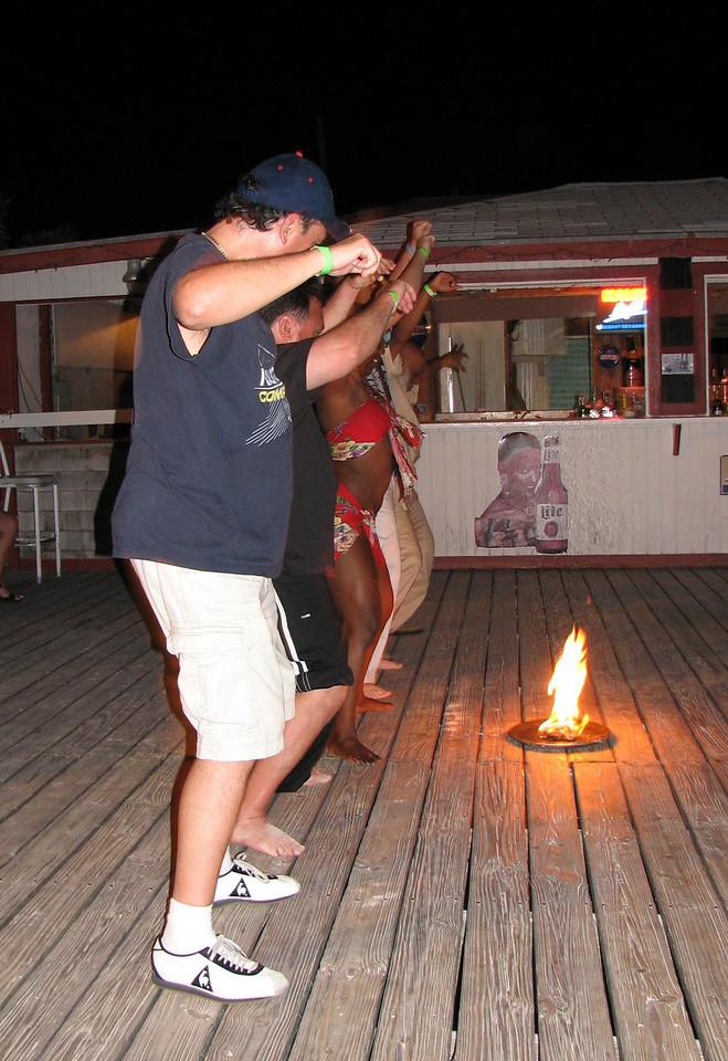 Now is Cesar's turn to dance the 'fire dance'...<br /> <br /> Ahora es el turno de Cesar de practicar el baile del fuego...