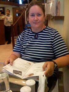 Pam checks the menu at Infinitea, one of the hip tea shops in Bangalore. India. Bangalore.