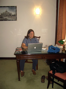 Pam settles in to our pleasant suite at the St. Marks hotel. India. Bangalore.