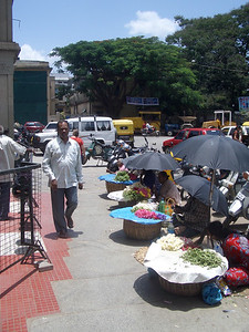 Flower vendors out front of the temple. India. Bangalore.