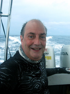 "Yours truly on the dive boat whizzing back to Kapalai after two great Sipadan dives  (the dive skin is the ""Abyss"" pattern from www.divegoddess.com )."