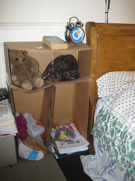 I know it looks designer, but not only did Ann make this nightstand all by herself, she even used recycled materials.