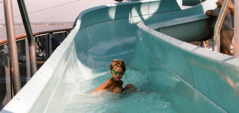 s cruising down the slide.