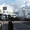 Vadis waiting for photographer at Canada Place - Island Princess Cruise ship in background