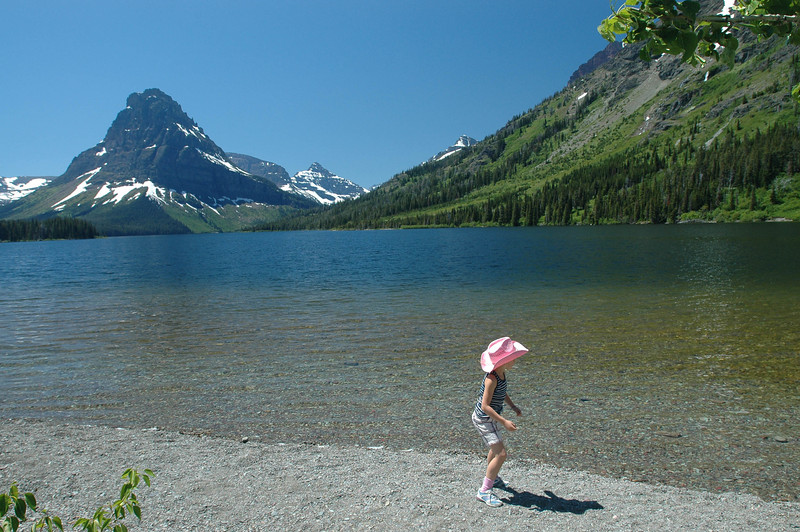 Jessie learning how to skip rocks on Two Medicine Lake where we had lunch.