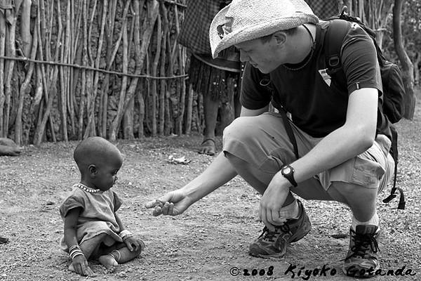Gaelan offers something to a Tatoga child