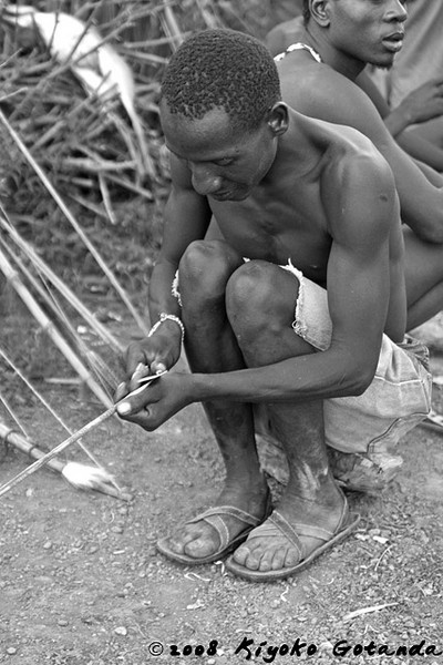 A Hadzabe male prepares his weapons to go hunting