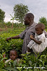 Emmanuel, with two of his children, show us some of his tea plantations