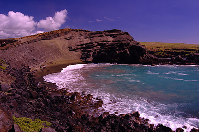 Puauaomahana, green sand beach near the southern most point in the the United State