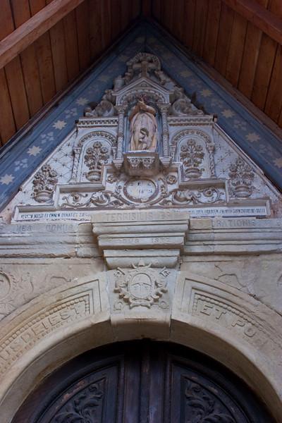 Doorway into Saint Mary Magdalene in Rennes-le-Château.  This church is where purportedly a major secret was discovered.  Read HOLY BLOOD HOLY GRAIL.