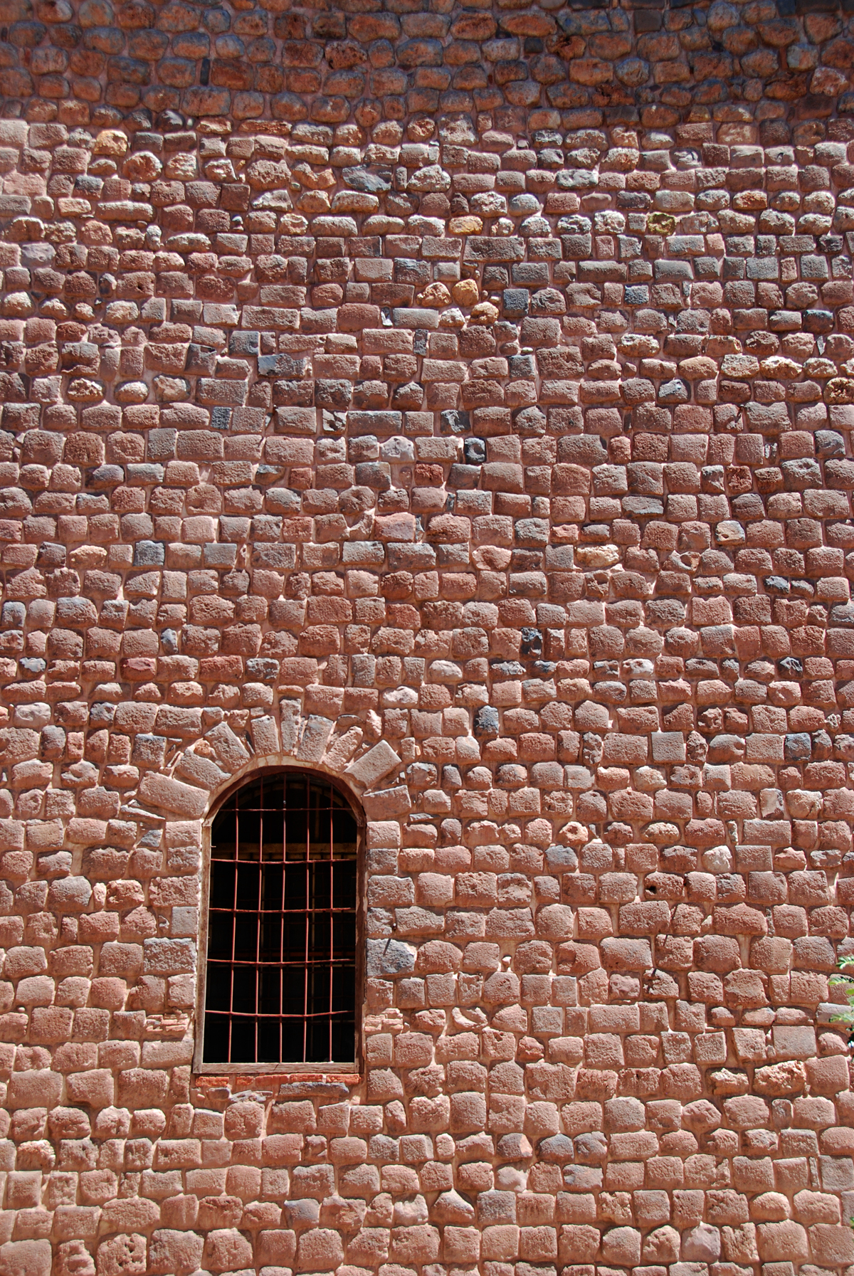 This is a window in the side of a church, not a prison.