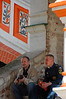 Sitting on the steps of St. Basil's, a father and son catch up during the son's off-duty time from the Emergencies Ministry, which handles natural and man-made disasters. (Alan)