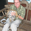 While Dad, Cheryl, Kay, and Melissa rode elephants I had a visit with a baby tiger.